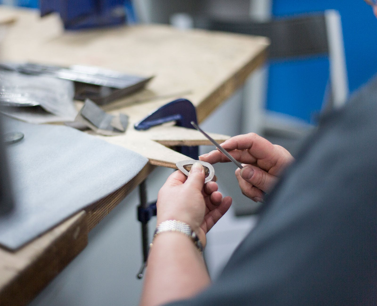 Student working on a piece of silver jewellery