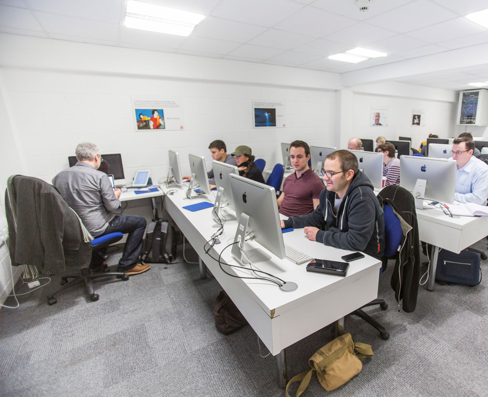 Students at computers working on web publishing software