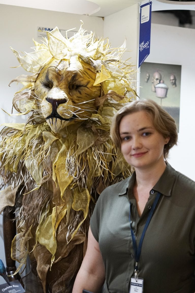 Charlotte Rees with Aslan