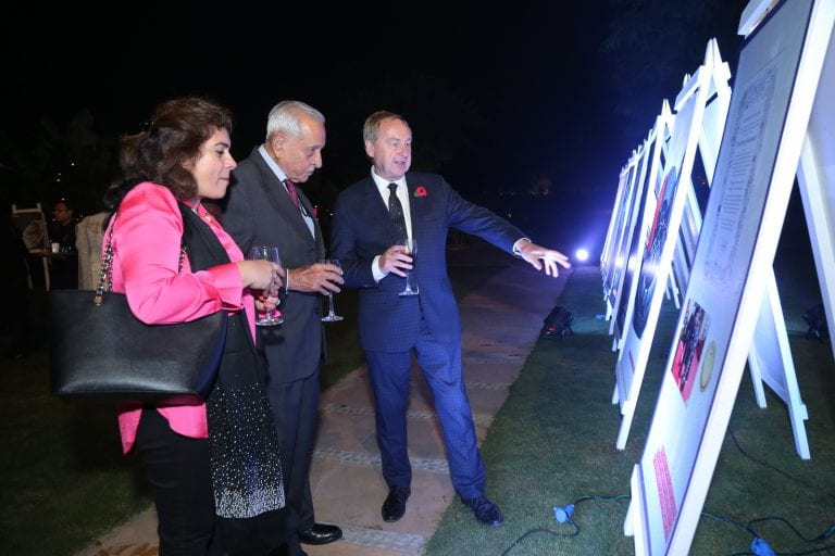 Principal and Vice Chancellor Professor Stuart Bartholomew CBE shows some examples of AUB's work to guests in the gardens of the British High Commissioner's residence