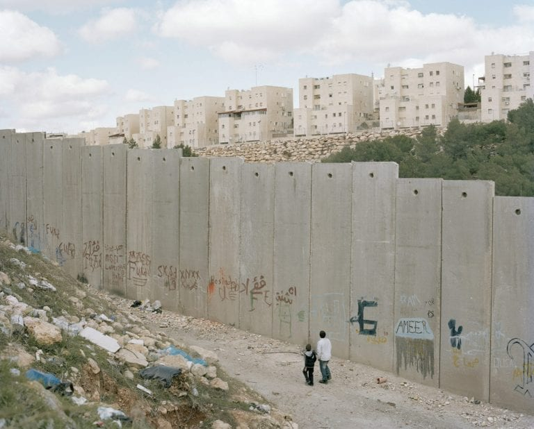 Israel's 'security wall' separates the Arab village of 'Anata' and Shu Fat from the Jewish settlement of 'Besigat Zeav' (on the other side of the wall) a Jewish 'settler' community of approx. 4,000 people.  Israel / Palestine  The wall has separated many Palestinian Arabs from the city of Jerusalem. Even though they technically live in Jerusalem – the wall now cuts them off them from central Jerusalem. Arab residents, now finding themselves on the 'wrong' side of the wall, fear that in addition to being cut off from the services and amenities of the city, they will now lose their 'Jerusalem Identity cards' also.